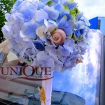 Aranjament floral lumanare botez hortensie albastra cu scoici tematica marina botez Iasi