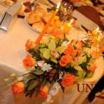 Aranjament floral prezidiu lumanari decorative portocalii orhidee verde Capitol Iasi