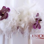 Lumanari nunta din pene si orhidee vanda